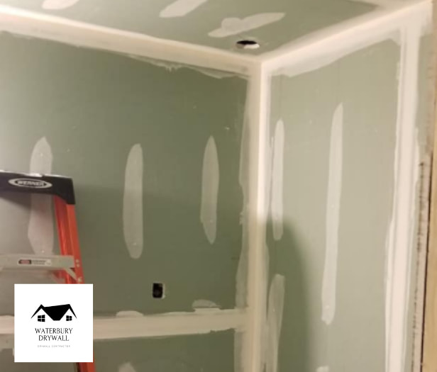 this is a picture of drywall being repaired by waterbury drywall